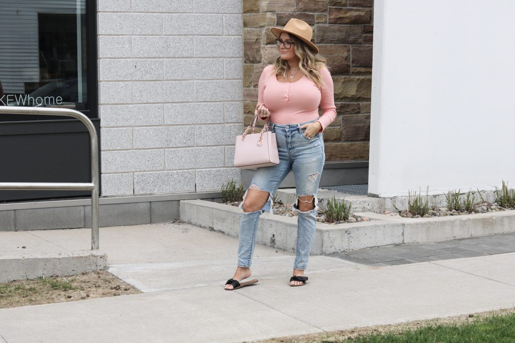 Casual look with pink long sleeve bodysuit and distressed jeans